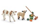 Schleich Stallskötsel med kalv och lamm