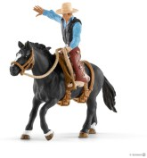 "Schleich ""Saddle bronc riding"" med cowboy"